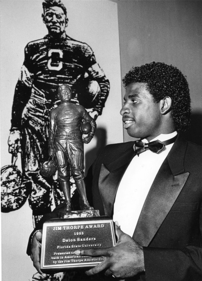 Photo - Deion Sanders (holding Jim Thorpe Award) played for the Florida State football team from 1985 to 1988. PHOTO FROM THE OKLAHOMAN ARCHIVE
