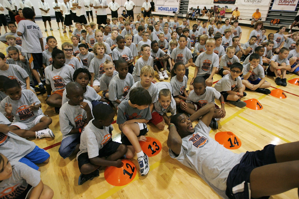 Photo - Kevin Durant takes a break from a shootout during the second day of the Kevin Durant basketball camp at Heritage Hall in Oklahoma City, Thursday, June 30, 2011.  (AP Photo/The Oklahoman, Garett Fisbeck)