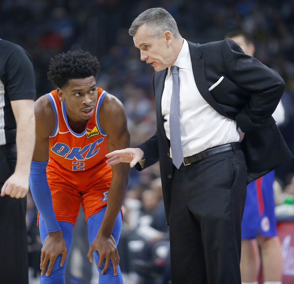 Photo - Oklahoma City coach Billy Donovan talks with Oklahoma City's Shai Gilgeous-Alexander (2) during an NBA basketball game between the Oklahoma City Thunder and the LA Clippers at Chesapeake Energy Arena in Oklahoma City, Sunday, Dec. 22, 2019. Oklahoma City won 118-112. [Bryan Terry/The Oklahoman]