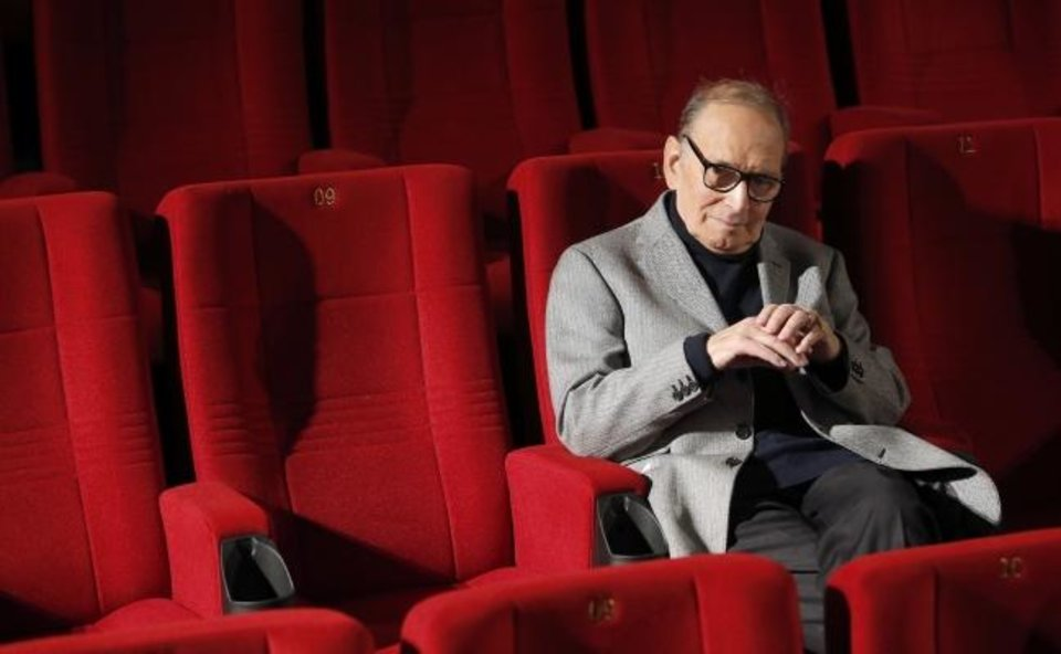 Photo -  In this Dec. 6, 2013 file photo, Italian composer Ennio Morricone poses during a photo call to promote his German 2014 concerts, in Berlin, Germany.[AP Photo/Michael Sohn, file]