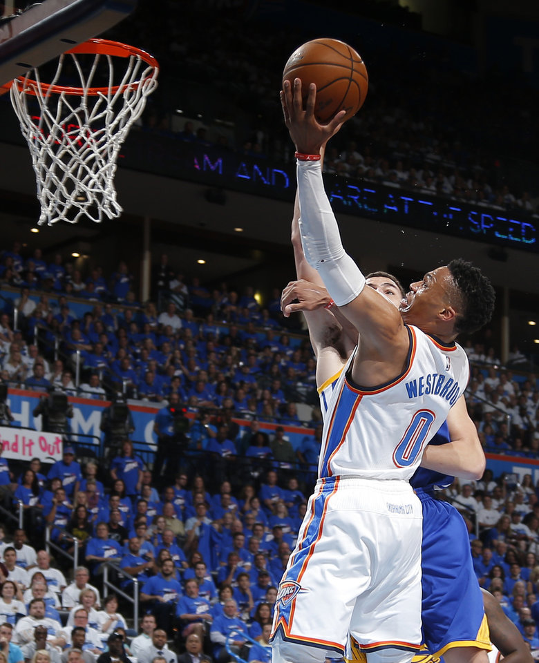 Photo - Oklahoma City's Russell Westbrook (0) goes to the basket during Game 3 of the Western Conference finals in the NBA playoffs between the Oklahoma City Thunder and the Golden State Warriors at Chesapeake Energy Arena in Oklahoma City, Sunday, May 22, 2016. Photo by Bryan Terry, The Oklahoman
