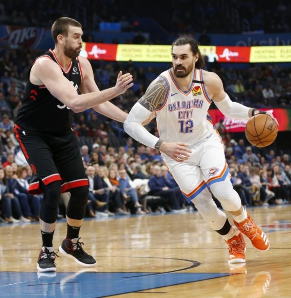 Photo -  Oklahoma City's Steven Adams, right, drives as Toronto's Marc Gasol defends in the second quarter of Wednesday night's game at Chesapeake Energy Arena. Adams would leave the game later in the quarter with a knee contusion and not return to the game. [Nate Billings/The Oklahoman]