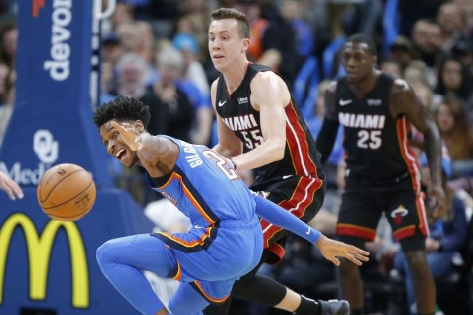 Photo -  Oklahoma City's Shai Gilgeous-Alexander (2) reaches for the ball in front of Miami's Duncan Robinson (55) during the Heat's 115-108 win Friday at Chesapeake Energy Arena. [Bryan Terry/The Oklahoman]