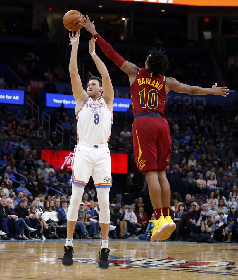 Photo - Oklahoma City's Danilo Gallinari (8) makes a basket beside Cleveland's Darius Garland (10) during an NBA basketball game between the Oklahoma City Thunder and the Cleveland Cavaliers at Chesapeake Energy Arena in Oklahoma City, Wednesday, Feb. 5, 2020. Oklahoma City won 109-103. [Bryan Terry/The Oklahoman]