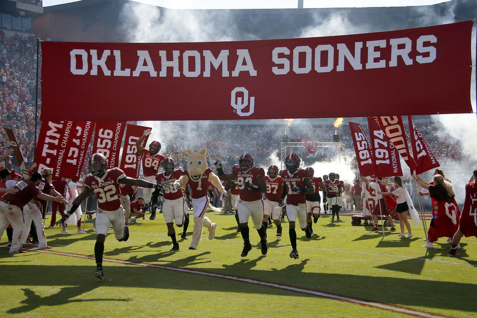 Photo - The Sooners take the field before a college football game between the University of Oklahoma Sooners (OU) and the West Virginia Mountaineers at Gaylord Family-Oklahoma Memorial Stadium in Norman, Okla, Saturday, Oct. 19, 2019. Oklahoma won 52-14. [Bryan Terry/The Oklahoman]