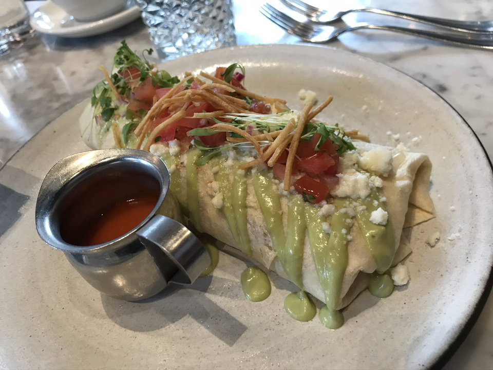 Photo - The Chilaquiles Breakfast Burrito at The Jones Assembly in Oklahoma City. [Dave Cathey/The Oklahoman]