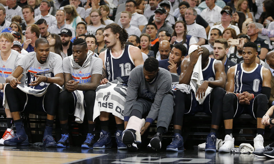 Photo - From left, Oklahoma City's Kyle Singler, Kevin Durant, Anthony Morrow, Steven Adams, Nazr Mohammed, Serge Ibaka and Russell Westbrook sit on the bench during Game 1 of the second-round series between the Oklahoma City Thunder and the San Antonio Spurs in the NBA playoffs at the AT&T Center in San Antonio, Saturday, April 30, 2016. San Antonio won 124-92. Photo by Bryan Terry, The Oklahoman