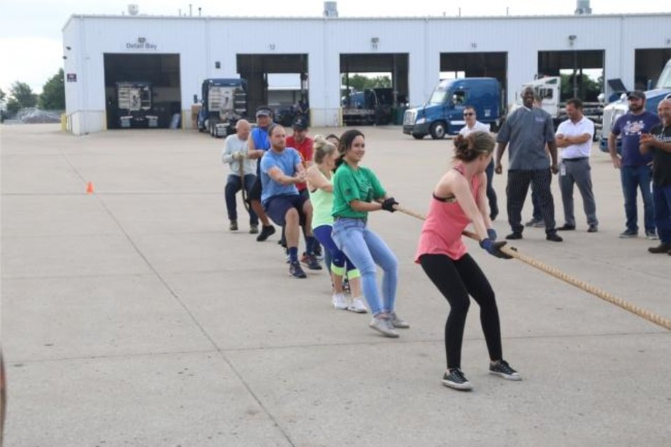 Photo -  Melton Truck Lines this year held its inagural Melton Olympics, consisting of a truck pull, fishing, a 5K run, frisbee and shotput.