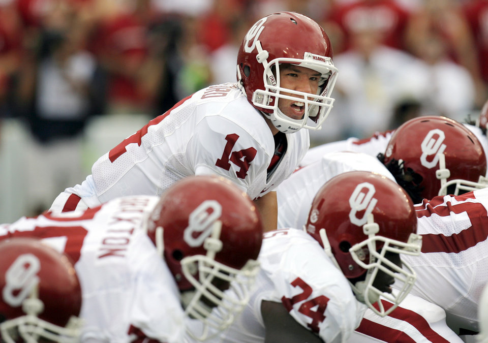 Photo - OU quarterback Sam Bradford calls a play at the line of scrimmage during the first half of the college football game between the University of Oklahoma Sooners (OU) and the University of Texas Longhorns (UT) at the Cotton Bowl in Dallas, Texas, on Saturday, Oct. 6, 2007. By Nate Billings, The Oklahoman  ORG XMIT: KOD