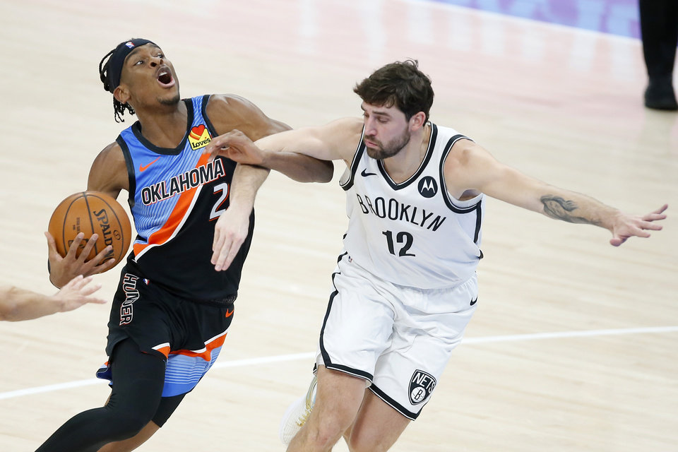 Photo - Oklahoma City's Shai Gilgeous-Alexander (2) is fouled by Brooklyn's Joe Harris (12) during an NBA basketball game between the Oklahoma City Thunder and the Brooklyn Nets at Chesapeake Energy Arena in Oklahoma City, Friday, Jan. 29, 2021. [Bryan Terry/The Oklahoman]