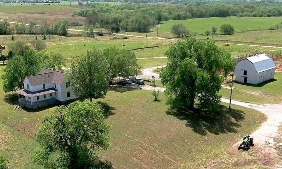 Photo -  An aerial view shows the late 19th-century farmhouse and surrounding Johnson Ranch land south of Norman. [PHOTO PROVIDED BY SCHRADER REAL ESTATE & AUCTION CO.]