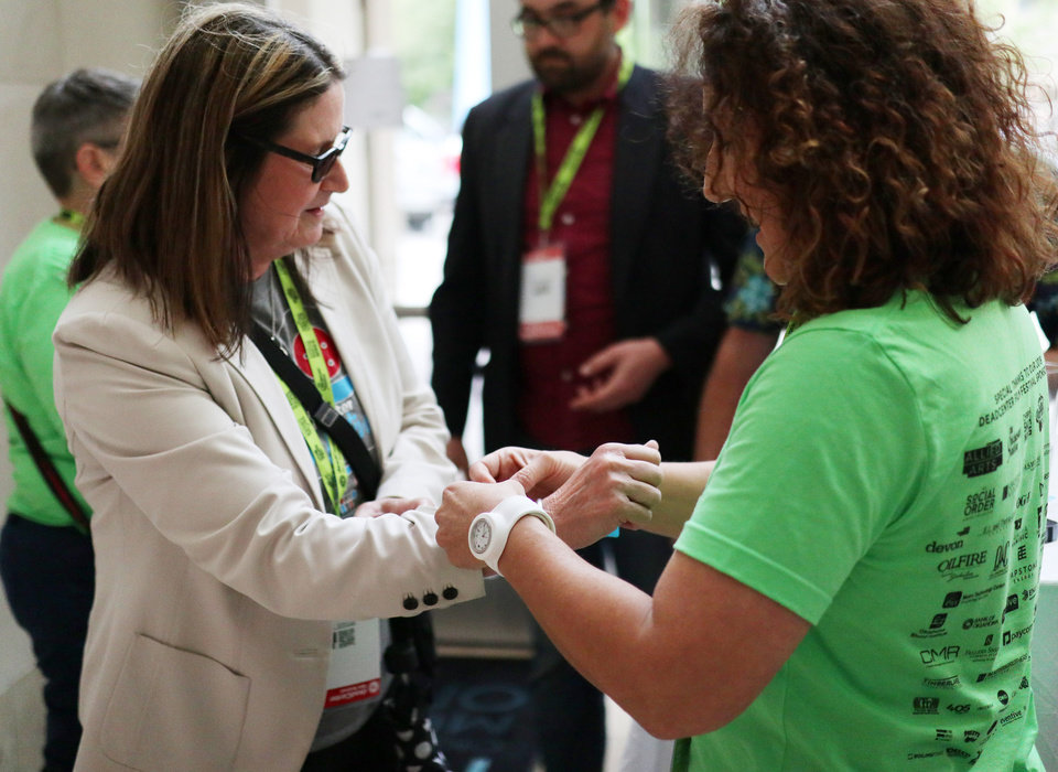 Photo - A patron gets her wrist band for the opening night reception in the lobby at opening night for deadCenter at the Oklahoma City Museum of Art, Thursday, June 6, 2019. [Doug Hoke/The Oklahoman]
