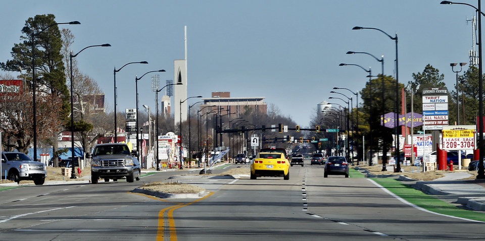 Photo -  Motorists drive along newly completed portions of W Lindsey Street in Norman.