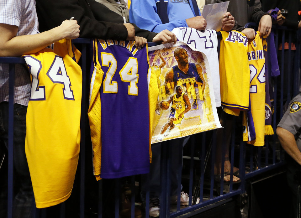 Photo - Fans wait with Kobe Bryant jerseys and posters hoping to get an autograph before an NBA basketball game between the Oklahoma City Thunder and the Los Angeles Lakers at Chesapeake Energy Arena in Oklahoma City, Monday, April 11, 2016. Photo by Nate Billings, The Oklahoman