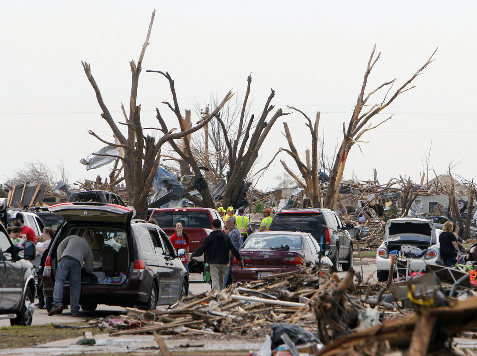 Photo - Volunteers and workers were out in force in the tornado devastated part of Moore, OK, Thursday, May 23, 2013,  Photo by Paul Hellstern, The Oklahoman