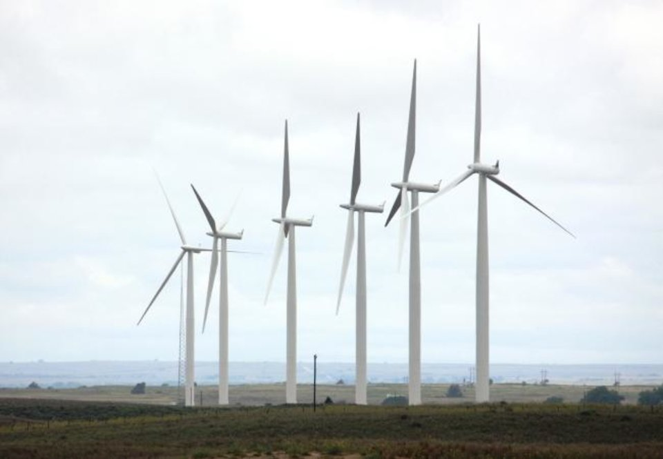Photo -  The OU Spirit wind farm, near Woodward, was built by OG&E after the University of Oklahoma made a commitment in 2008 to operate using 100% renewable power by 2013. Universities and corporations have supported growth of renewable power projects by entering into power purchase agreements. [THE OKLAHOMAN ARCHIVES]