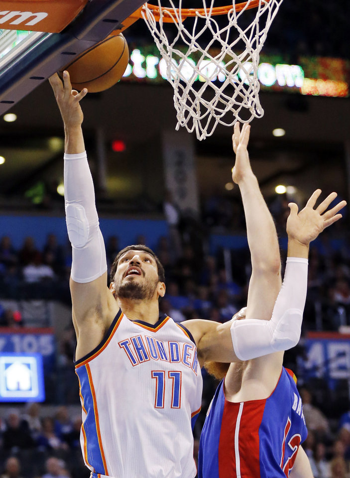 Photo - Oklahoma City's Enes Kanter (11) shoots against Detroit's Aron Baynes (12) during an NBA basketball game between the Oklahoma City Thunder and the Detroit Pistons at Chesapeake Energy Arena in Oklahoma City, Saturday, Nov. 26, 2016. Photo by Nate Billings, The Oklahoman