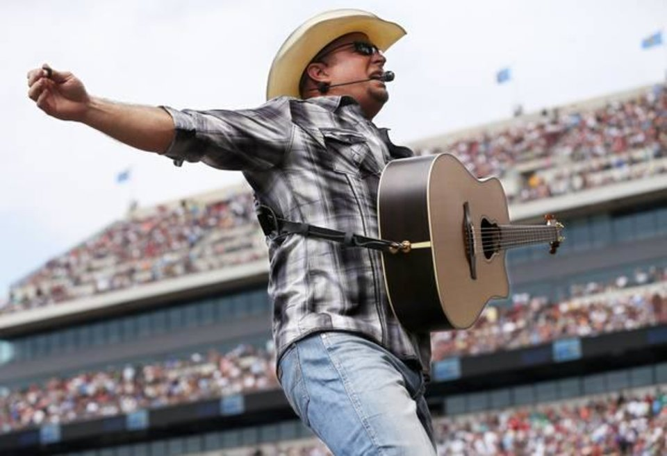 Photo - Garth Brooks performs during the Oklahoma Twister Relief Concert, benefiting victims of the May tornadoes, at Gaylord Family - Oklahoma Memorial Stadium on the campus of the University of Oklahoma in Norman, Okla., Saturday, July 6, 2013. Photo by Nate Billings, The Oklahoman Archives