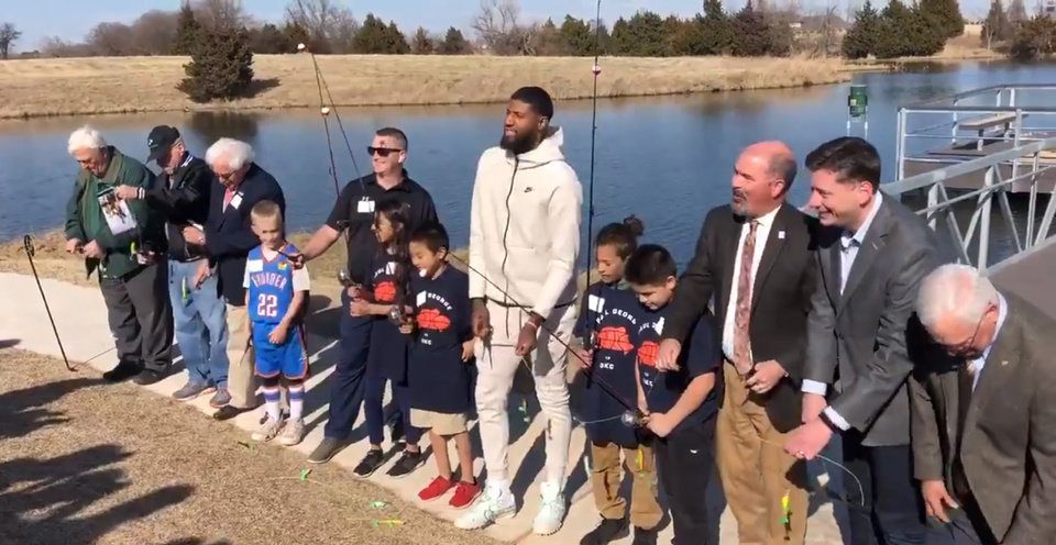 Photo -  Former OKC Thunder player Paul George dedicates a new fishing dock in Oklahoma City. [Maddie Lee/The Oklahoman]