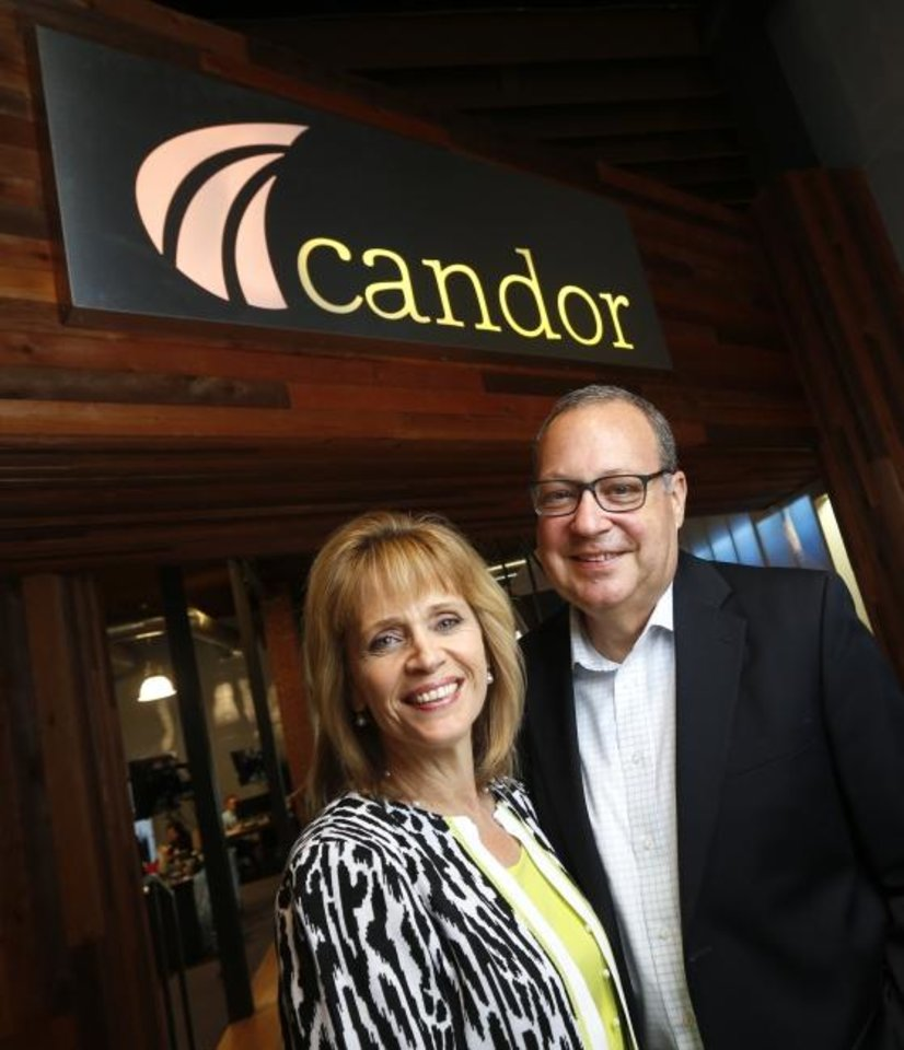 Photo -  Karen Wicker and husband Jim Kessler are partners in life and work. Wicker is founder and CEO of Candor public relations and marketing firm. A former business consultant, Kessler now manages Candor's back-office operations. [NATE BILLINGS/THE OKLAHOMAN]