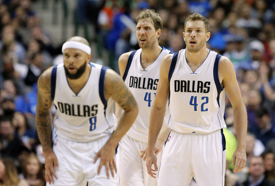 Photo - Dallas Mavericks' Deron Williams (8), Dirk Nowitzki, rear, and David Lee (42) guard down court in the second half of an NBA basketball game against the Oklahoma City Thunder on Wednesday, Feb. 24, 2016, in Dallas. Lee played his first game for the Mavericks in the 116-103 loss to the Thunder. (AP Photo/Tony Gutierrez)