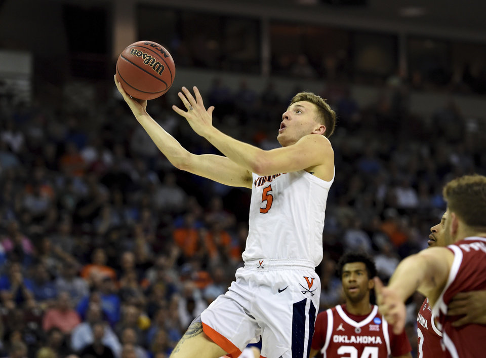 Photo - Virginia's Kyle Guy (5) drives for a layup during the second half of a second round men's college basketball game against Oklahoma in the NCAA Tournament in Columbia, S.C. Sunday, March 24, 2019. (AP Photo/Richard Shiro)