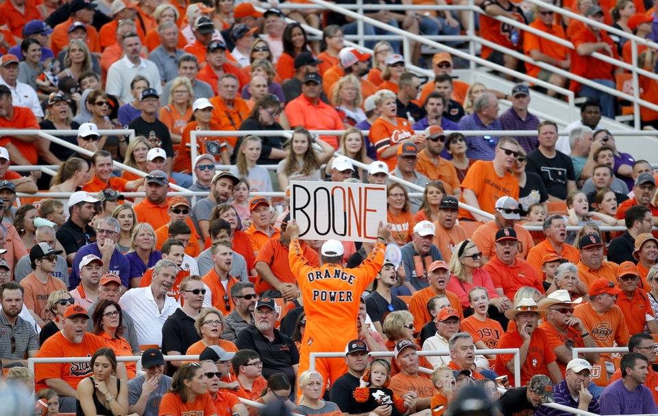 Photo - A fan encourages other fans to cheer during the college football game between the Oklahoma State Cowboys and the Kansas State Wildcats at Boone Pickens Stadium in Stillwater, Okla., Friday, Sept. 27, 2019. [Sarah Phipps/The Oklahoman]