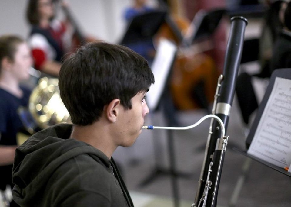 Photo - Julian Guajardo plays the bassoon during practice with El Sistema Oklahoma at First Presbyterian Church of Oklahoma City in Oklahoma City, Thursday, Sept. 19, 2019. [Sarah Phipps/The Oklahoman]