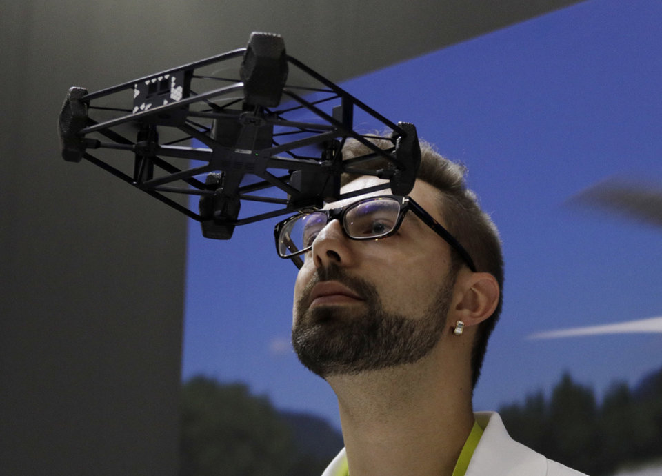 Photo - Alex Shapilsky flies the AEE Rova drone near his head at the AEE booth during CES International, Thursday, Jan. 5, 2017, in Las Vegas. (AP Photo/John Locher)