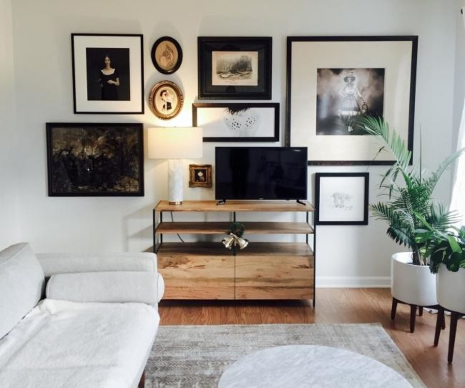 Photo -  A gallery wall designed by West Elm's Design Crew and hung by its Installation Service. [WEST ELM]
