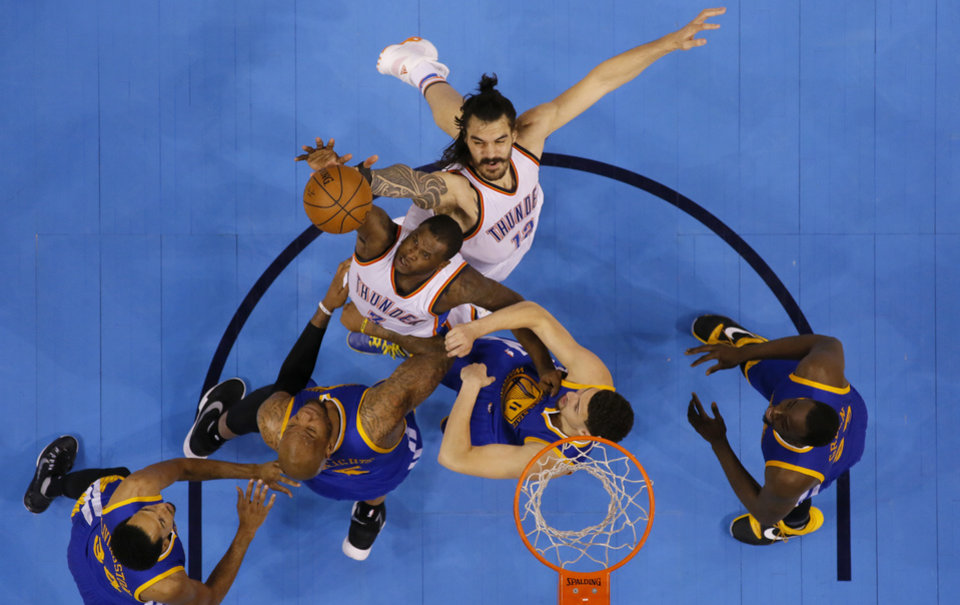 Photo - Oklahoma City's Dion Waiters (3) and Steven Adams (12) fight for a rebound during during Game 6 of the Western Conference finals in the NBA playoffs between the Oklahoma City Thunder and the Golden State Warriors at Chesapeake Energy Arena in Oklahoma City, Saturday, May 28, 2016. Photo by Sarah Phipps, The Oklahoman