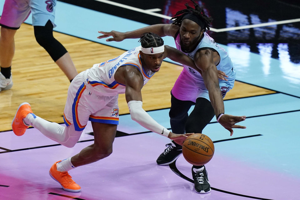 Photo - Miami Heat forward Precious Achiuwa (5) defends Oklahoma City Thunder guard Shai Gilgeous-Alexander (2) during the second half of an NBA basketball game, Monday, Jan. 4, 2021, in Miami. (AP Photo/Marta Lavandier)