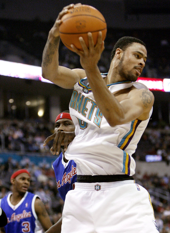 Photo - The Hornets' Tyson Chandler grabs a rebound in the second half during the NBA basketball game between the New Orleans/Oklahoma City Hornets and the Los Angeles Clippers at the Ford Center in Oklahoma City, Monday, Jan. 8, 2007. By James Plumlee, The Oklahoman ORG XMIT: KOD