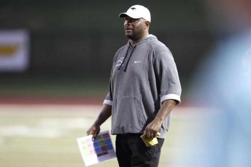 Photo -  Southmoore coach Josh Norman is one of two Black head football coaches in the Moore district at Class 6A schools. The former OU starter is in his first season at the school. [Bryan Terry/The Oklahoman]