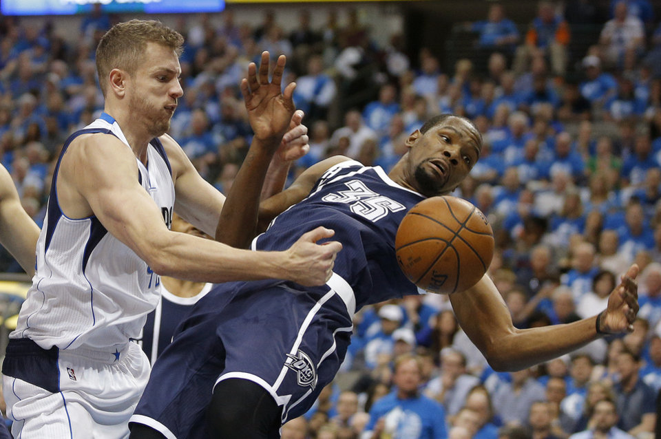 Photo - Oklahoma City's Kevin Durant (35) fights for the ball with Dallas' David Lee (42) during Game 3 of the first round series between the Oklahoma City Thunder and the Dallas Mavericks in the NBA playoffs at American Airlines Center in Dallas, Thursday, April 21, 2016. The Thunder won 131-102. Photo by Bryan Terry, The Oklahoman