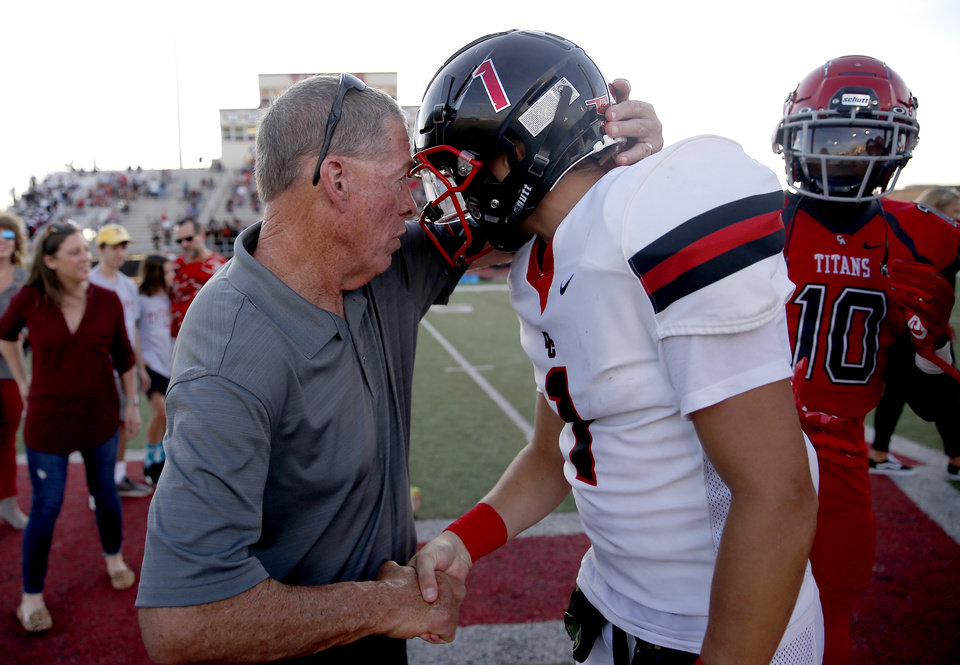 Photo - Gary Rose talks with Del City's Colin Liesinger before the high school football game between Carl Albert and Del City at Carl Albert High School in Midwest City, Okla., Friday, Sept. 13, 2019. [Sarah Phipps/The Oklahoman]