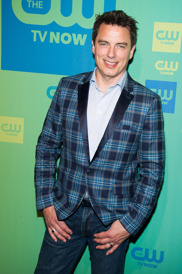 Photo - John Barrowman attends the CW Network Upfront on Thursday, May 15, 2014 in New York. (Photo by Charles Sykes/Invision/AP)