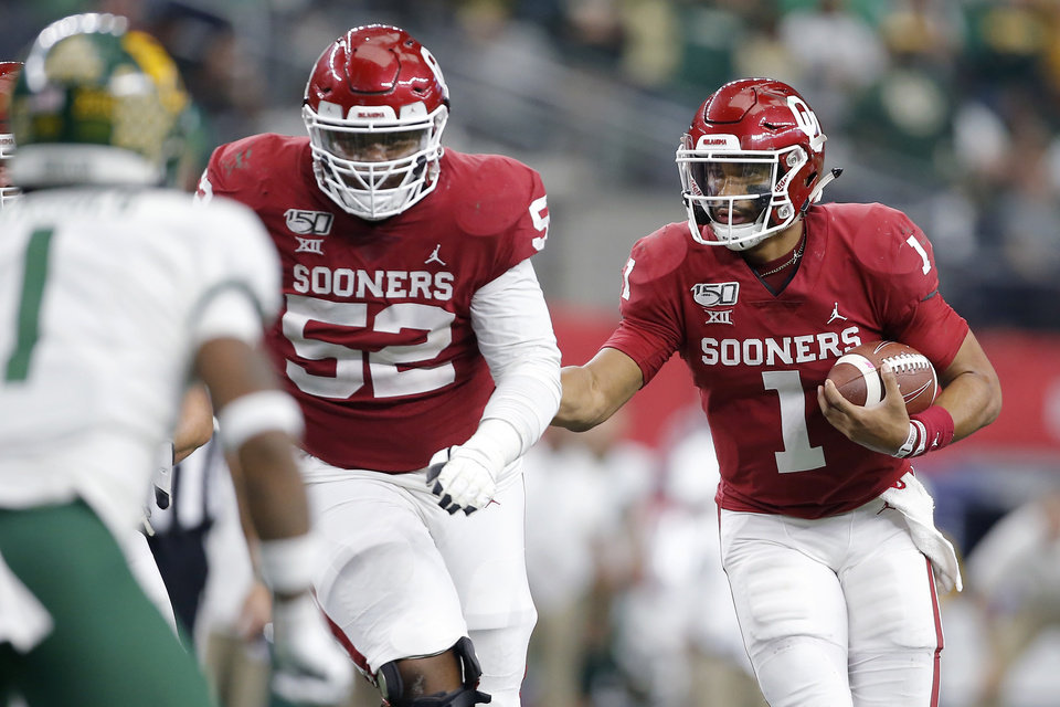 Photo - Oklahoma's Jalen Hurts (1) carries the ball during the Big 12 Championship Game between the University of Oklahoma Sooners (OU) and the Baylor University Bears at AT&T Stadium in Arlington, Texas, Saturday, Dec. 7, 2019. Oklahoma won 30-23. [Bryan Terry/The Oklahoman]