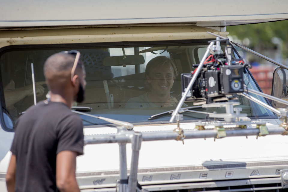 Photo -  Tom Felton sits in an RV on Aug. 3 during filming for movie