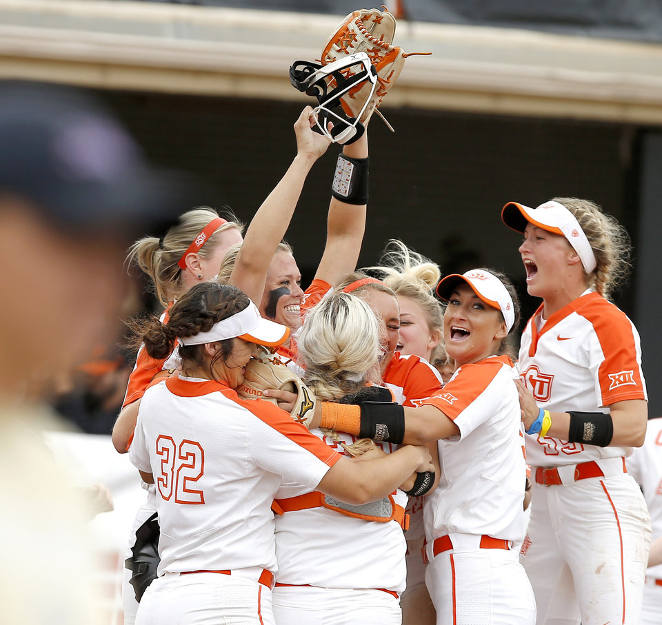 Photo - Oklahoma State celebrates after winning the Stillwater Regional NCAA softball tournament game between Oklahoma State University (OSU) and Tulsa in Stillwater, Okla., Saturday, May 18, 2019. Oklahoma State won 2-1. [Bryan Terry/The Oklahoman]
