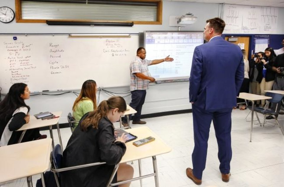 Photo -  Gov. Kevin Stitt visits John Hill's AP calculus class on Wednesday afternoon at Southeast. Stitt spent about 45 minutes at the school.