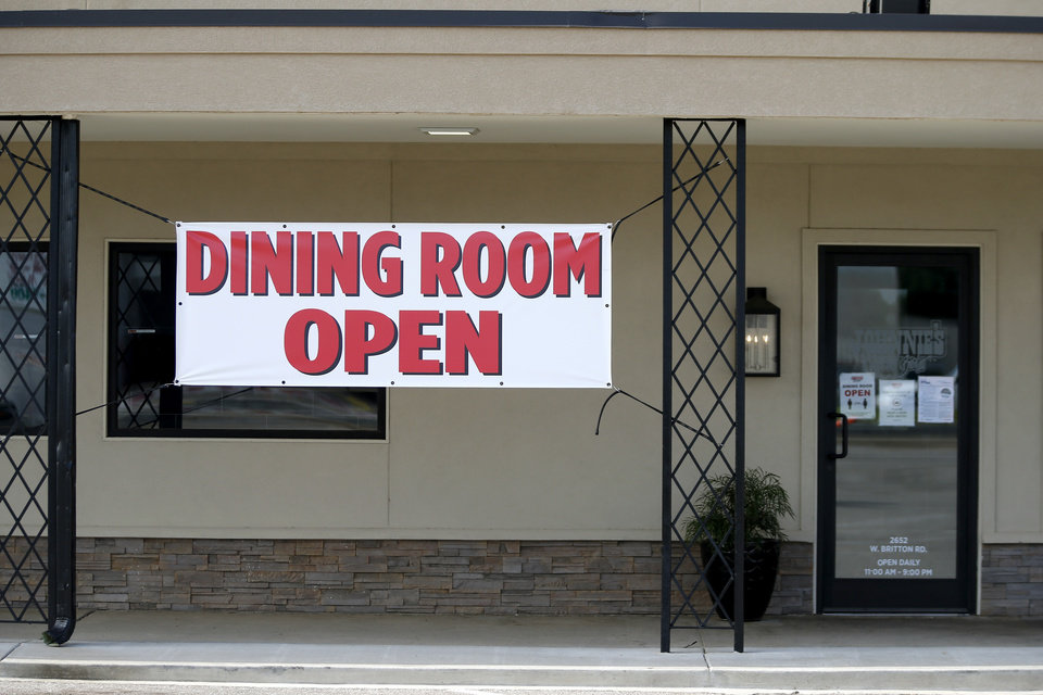 Photo -  A sign on Johnnie's Charcoal Broiler in Oklahoma City tells potential guests its dining room is open. [Bryan Terry/The Oklahoman]