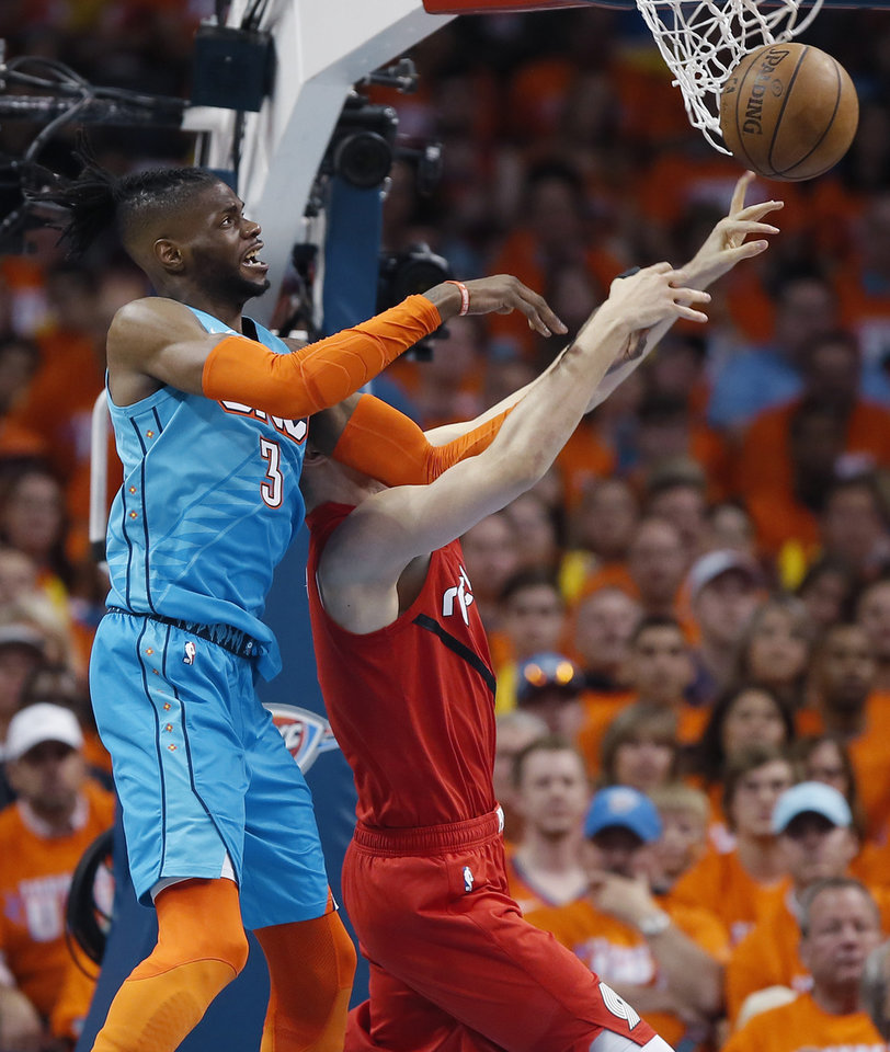 Photo - Oklahoma City's Nerlens Noel (3) goes for a rebound over Portland's Zach Collins (33) during Game 3 in the first round of the NBA playoffs between the Portland Trail Blazers and the Oklahoma City Thunder at Chesapeake Energy Arena in Oklahoma City, Friday, April 19, 2019. Photo by Bryan Terry, The Oklahoman