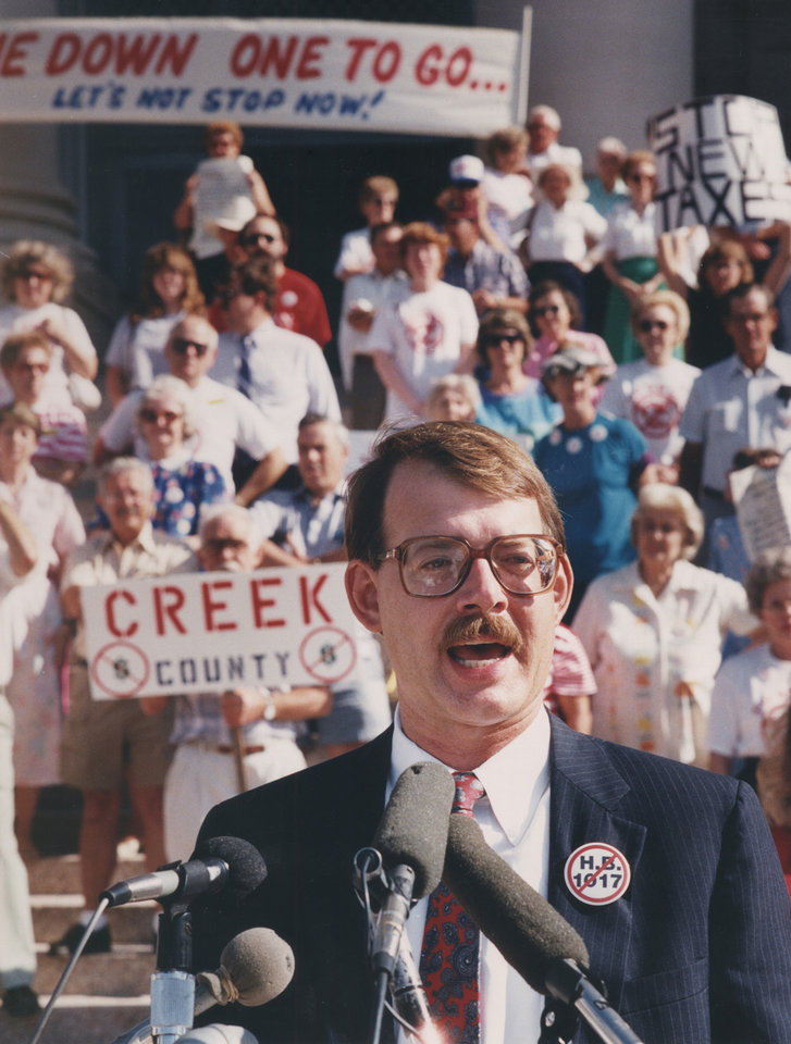 Photo - Dan Brown, chairman of STOP New Taxes, spoke at an anti-tax rally July 16, 1990, on the south steps of the state Capitol. [Photo by Jim Beckel, The Oklahoman Archives]
