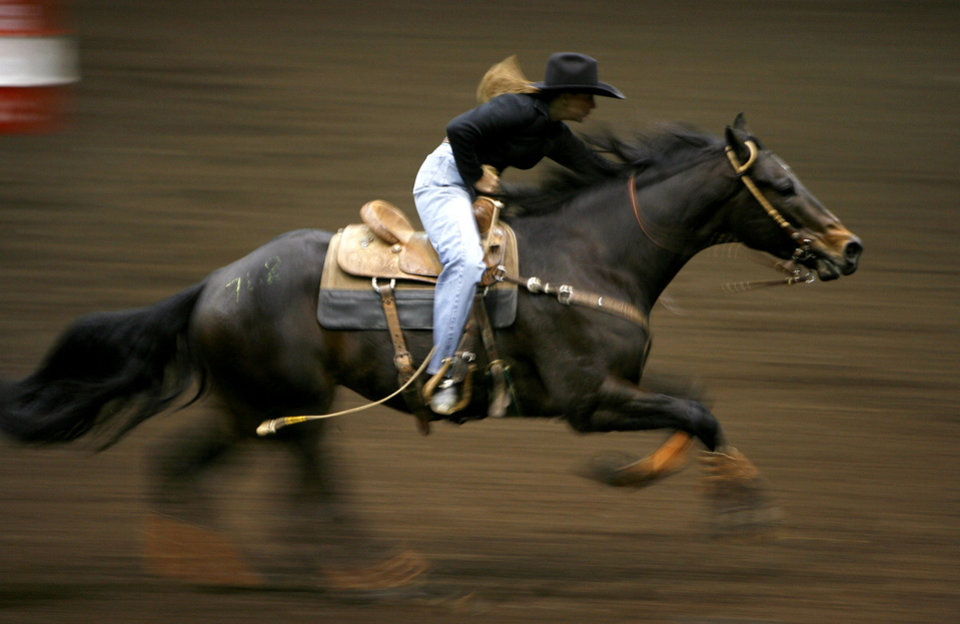 Photo - Bo Hill rides Kerney during the World Championship Barrel Racing Futurity at the State Fair Arena in Oklahoma City on Thursday, Dec., 6, 2007. By Bryan Terry, The Oklahoman ORG XMIT: KOD
