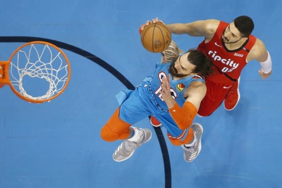 Photo -  Driving to the basket for dunks hasn't been an issue for Thunder center Steven Adams. [Bryan Terry/The Oklahoman]
