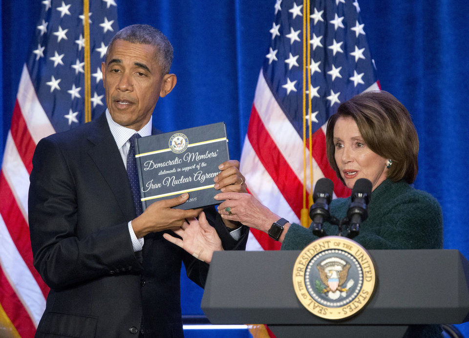 Photo -  FILE - In this Jan. 28, 2016 file photo, President Barack Obama, left, is presented a copy of the Iran Nuclear Agreement Legislation by House Minority Leader Nancy Pelosi, in Baltimore, Md. President-elect Joe Biden has pledged to potentially return American to Iran's 2015 nuclear deal with world powers, which saw Tehran limit its enrichment of uranium in exchange for the lifting of economic sanctions. Trump unilaterally pulled out of the deal in 2018. (AP Photo/Pablo Martinez Monsivais, File)