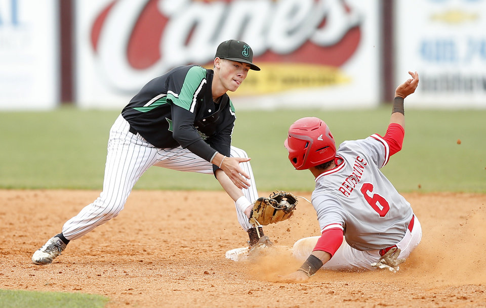Photo - Jarren Maples of Jones tags out Kingston's Ty Herndon at second base during a Class 3A state baseball game at Edmond Memorial in Edmond, Okla., Thursday, May 9, 2019. [Bryan Terry/The Oklahoman]