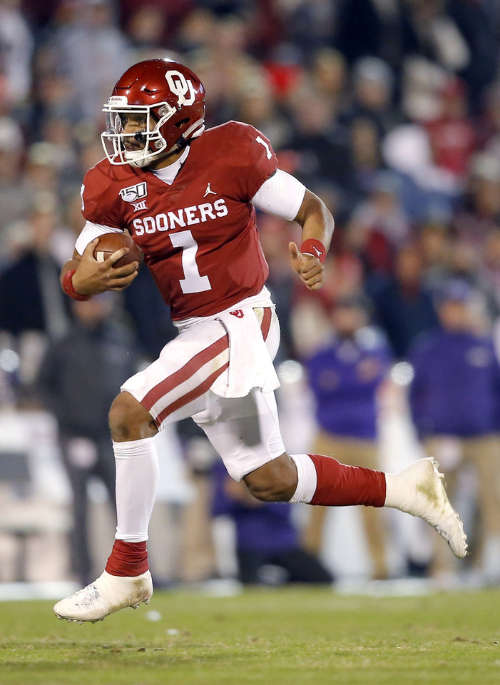 Photo - Oklahoma's Jalen Hurts (1) rushes in the fourth quarter during an NCAA football game between the University of Oklahoma Sooners (OU) and the TCU Horned Frogs at Gaylord Family-Oklahoma Memorial Stadium in Norman, Okla., Saturday, Nov. 23, 2019. OU won 28-24. [Sarah Phipps/The Oklahoman]
