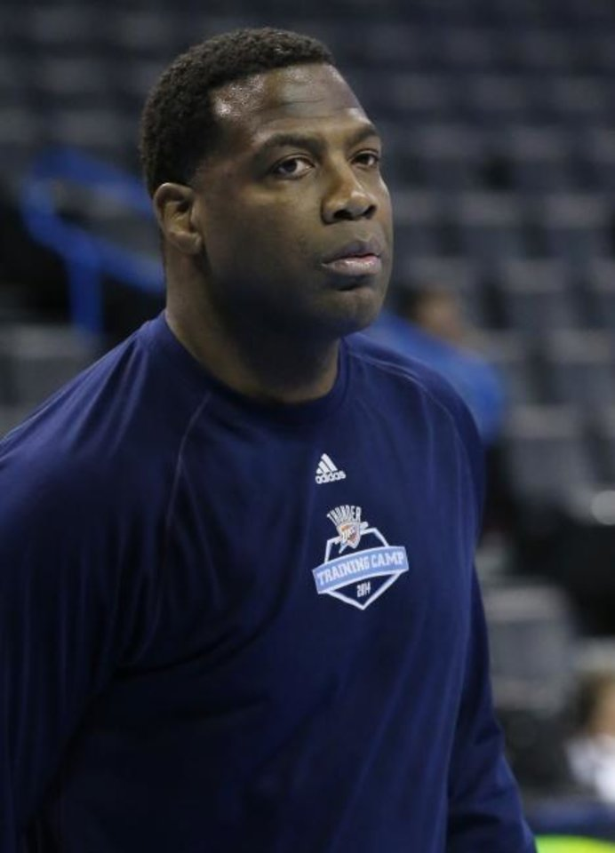Photo -  Oklahoma City Thunder assistant coach Mark Bryant is pictured during pre-game warm-ups before the start of an NBA basketball game against the Utah Jazz in Oklahoma City, Friday, Jan. 9, 2015. (AP Photo/Sue Ogrocki)